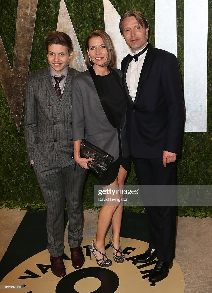 Actor Mads Mikkelsen (R) poses with son Carl Mikkelsen and wife Hanne Jacobsen at the 2013 Vanity Fair Oscar Party at the Sunset Tower Hotel on February 24, 2013 in West Hollywood, California.
