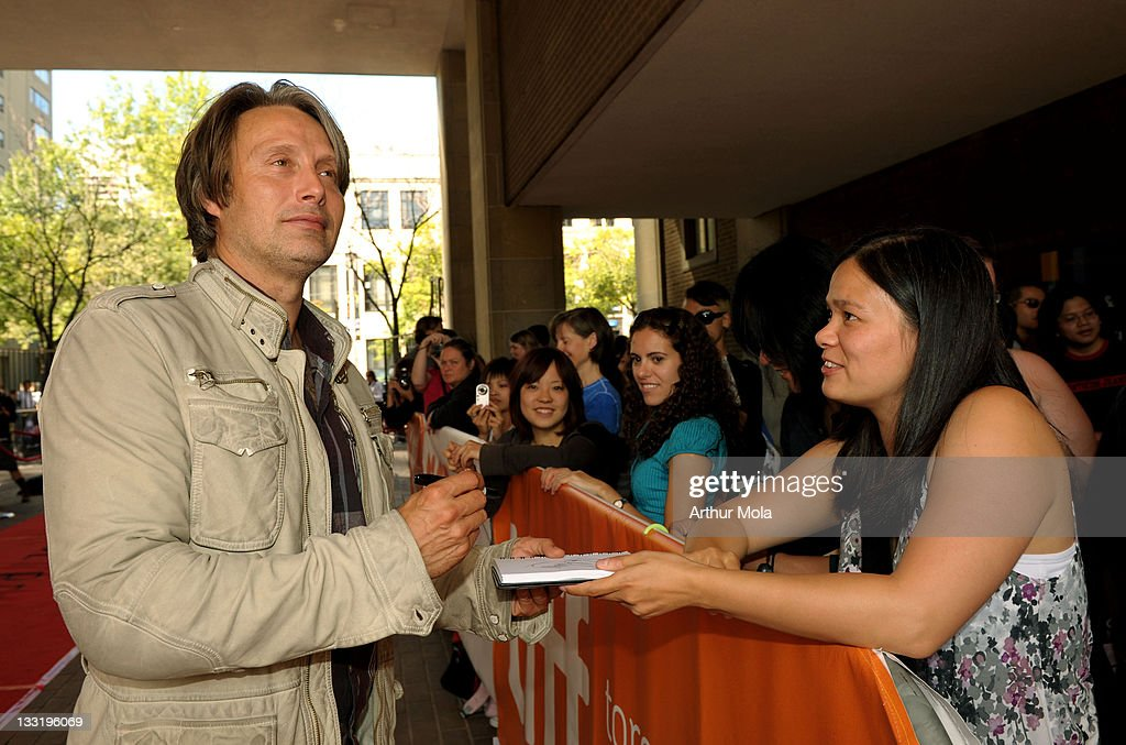 Actor Mads Mikkelsen signs autographs at the'Valhalla Rising' Premiere at the Ryerson Theatre during the 2009 Toronto International Film Festival on...