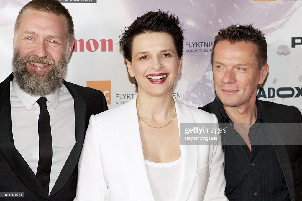 Actor Mads Ousdal, actress <a gi-track='captionPersonalityLinkClicked' href=/galleries/search?phrase=Juliette+Binoche&family=editorial&specificpeople=209273 ng-click='$event.stopPropagation()'>Juliette Binoche</a> and U2 drummer Larry Mullen Jr attend the Oslo premiere of 'A Thousand Times Good Night' at Colosseum on October 16, 2013 in Oslo, Norway.