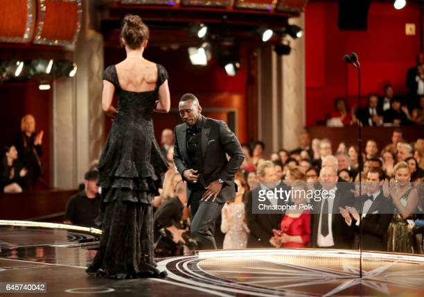 Actor Mahershala Ali accepts the Best Supporting Actor award for 'Moonlight' from actor Alicia Vikander onstage during the 89th Annual Academy Awards...