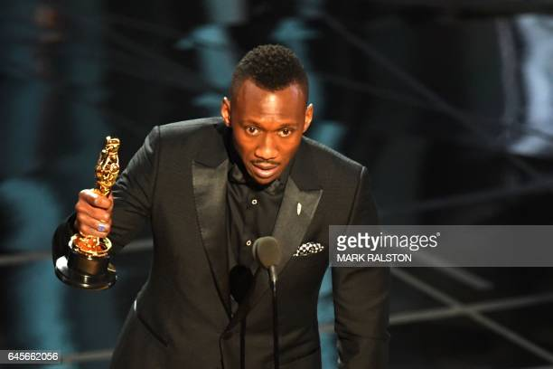 US Actor Mahershala Ali delivers a speech on stage after he won the award for Best Supporting Actor in 'Moonlight' at the 89th Oscars on February 26...