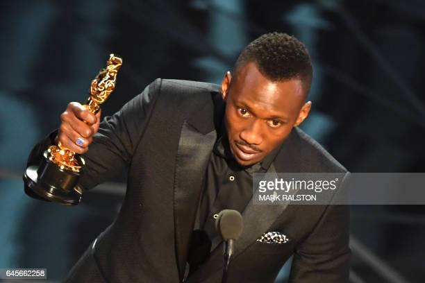 Actor Mahershala Ali delivers a speech on stage after he won the award for Best Supporting Actor in 'Moonlight' at the 89th Oscars on February 26...