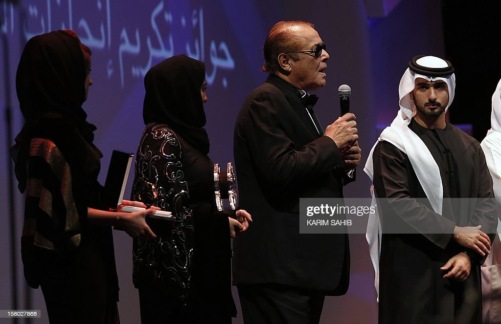 Actor Mahmud Abdel Aziz (2R) speaks after receiving an IWC watch, as part of the Lifetime Achievement award presentated by Sheikh Mansur bin Mohammed bin Rashid al-Maktoum (R) at the Dubai International Film Festival in the Gulf emirate of Dubai, on December 9, 2012. AFP PHOTO/KARIM SAHIB