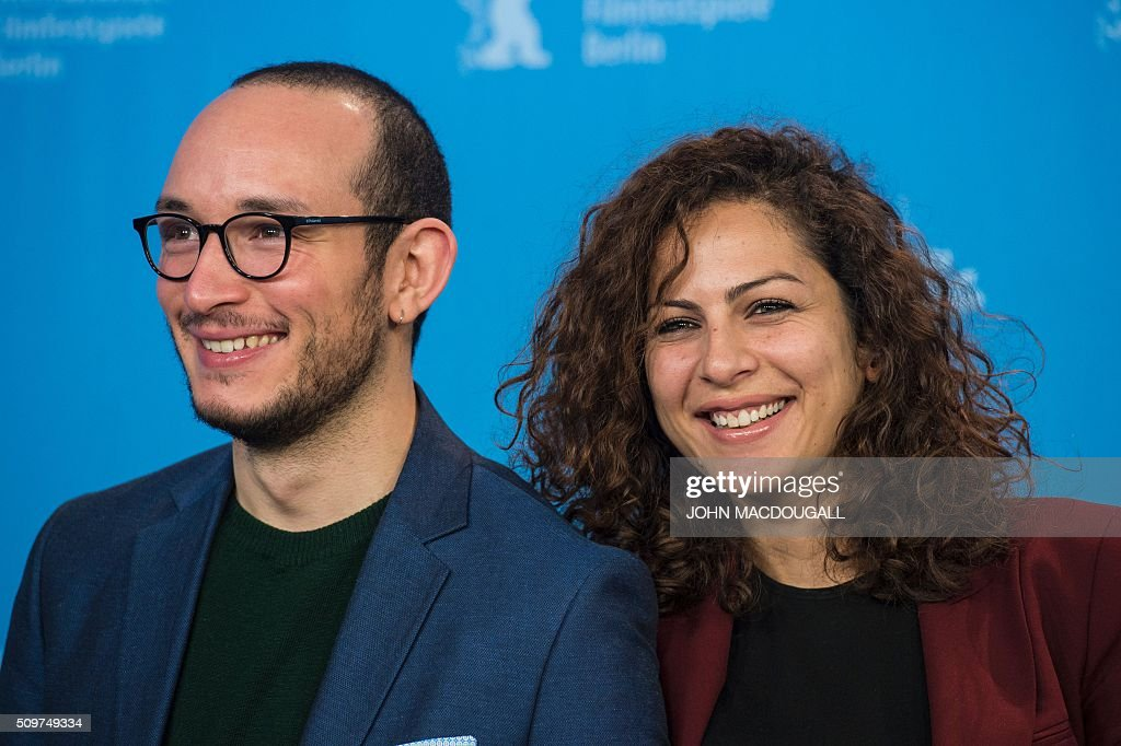 Actor Majjd Mastoura and actress Rym Ben Mesaoud pose during a photocall for the Tunisian film ' Inhebbek Hedi ' (Hedi) during the Berlinal Film Festival in Berlin on February 12, 2016. / AFP / John MACDOUGALL