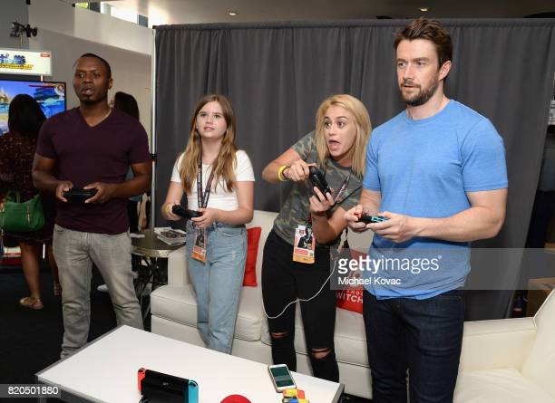 Actor Malcolm Goodwin actress Kyla Kennedy Allie Punch and actor Robert Buckley from the television series iZombie stopped by Nintendo at the TV...