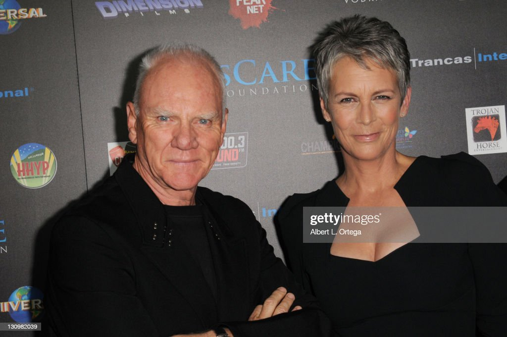 Actor <a gi-track='captionPersonalityLinkClicked' href=/galleries/search?phrase=Malcolm+McDowell+-+Actor&family=editorial&specificpeople=221446 ng-click='$event.stopPropagation()'>Malcolm McDowell</a> and actress <a gi-track='captionPersonalityLinkClicked' href=/galleries/search?phrase=Jamie+Lee+Curtis&family=editorial&specificpeople=202231 ng-click='$event.stopPropagation()'>Jamie Lee Curtis</a> arrive for the sCare Foundation's 1st Annual Halloween Launch Benefit held at The Conga Room at L.A. Live on October 30, 2011 in Los Angeles, California.