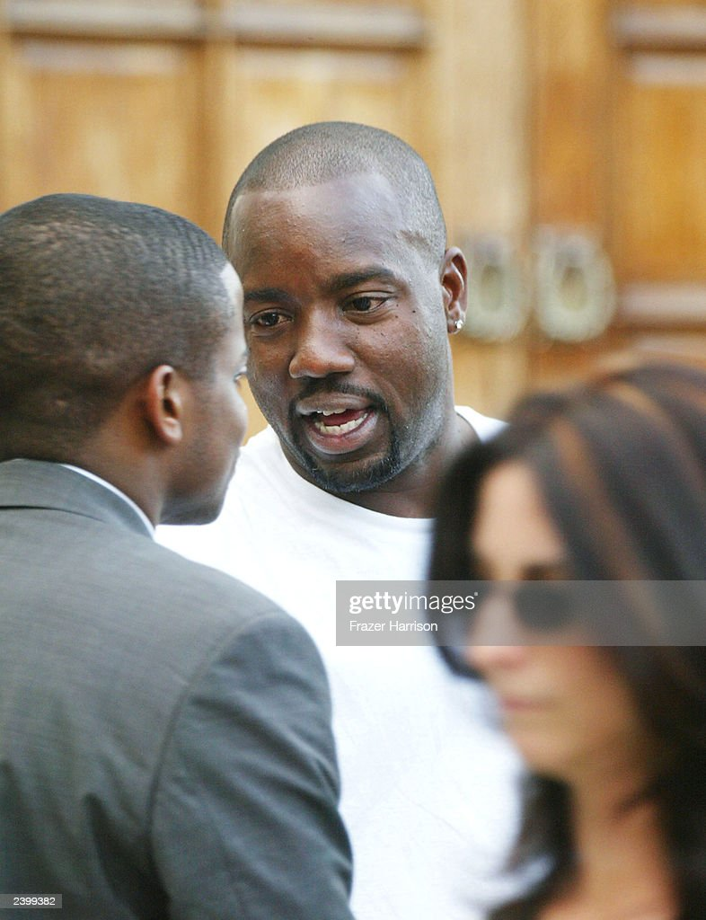 Actor Malik Yoba (C) attends the memorial service at Saint Monica's Catholic Church held for actor/dancer Gregory Hines on August 13, 2003 in Santa Monica, California.