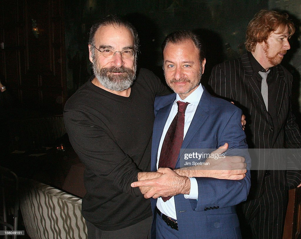 Actor <a gi-track='captionPersonalityLinkClicked' href=/galleries/search?phrase=Mandy+Patinkin&family=editorial&specificpeople=233720 ng-click='$event.stopPropagation()'>Mandy Patinkin</a> and actor/director <a gi-track='captionPersonalityLinkClicked' href=/galleries/search?phrase=Fisher+Stevens&family=editorial&specificpeople=206958 ng-click='$event.stopPropagation()'>Fisher Stevens</a> attends The Cinema Society With Chrysler & Bally Host The Premiere Of 'Stand Up Guys' After Party at The Plaza Hotel on December 9, 2012 in New York City.