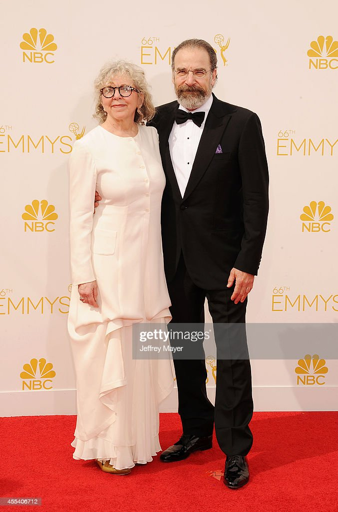 Actor Mandy Patinkin (L) and Kathryn Grody arrive at the 66th Annual Primetime Emmy Awards at Nokia Theatre L.A. Live on August 25, 2014 in Los Angeles, California.