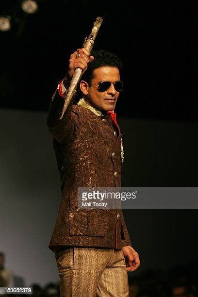 Actor Manoj Bajpai displays creation of designer Samant Chauhan during the Wills Lifestyle India Fashion Week 2012 in New Delhi on Sunday