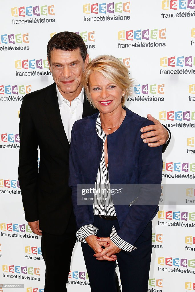 Actor Marc Lavoine and TV Presenter Sophie Davant pose at the Photocall during the Telethon 2015 Press Conference at France Television on November 4, 2015 in Paris, France.