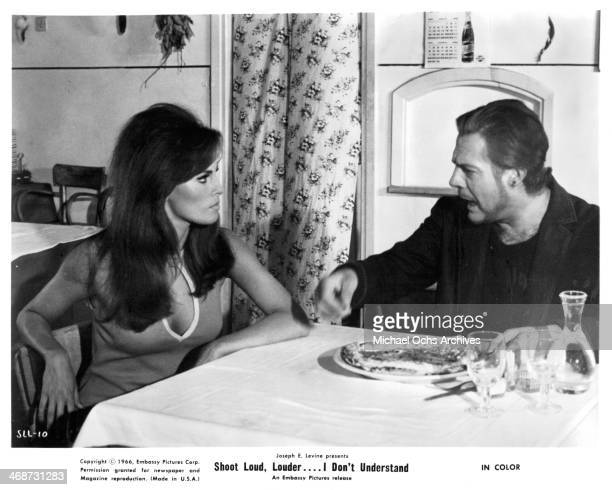 Actor Marcello Mastroianni and actress Raquel Welch on set of the movie 'Shoot Loud Louder I Don't Understand ' circa 1966