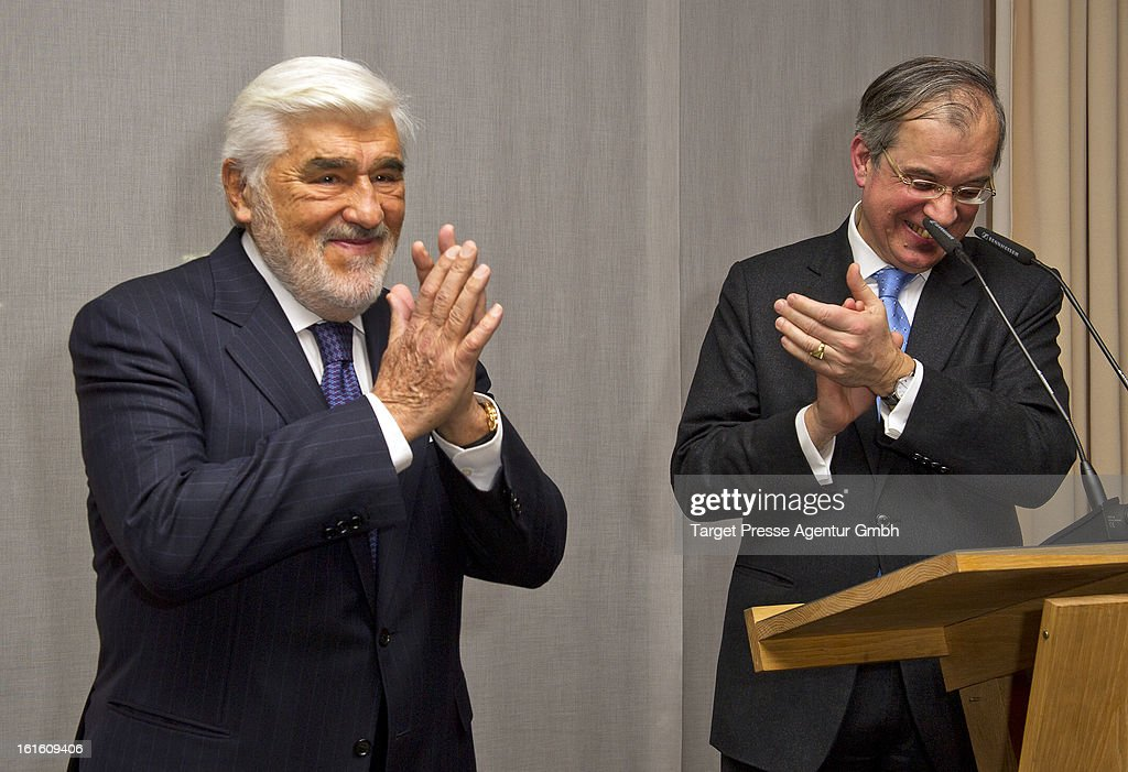 Actor Mario Adorf and French embassador Maurice Gourdault-Montagne celebrate at the French embassy the awarding of the medal 'Chevalier Des Arts Et Des Lettres' at the 'Soiree Francaise Du Cinema' on February 12, 2013 in Berlin, Germany.