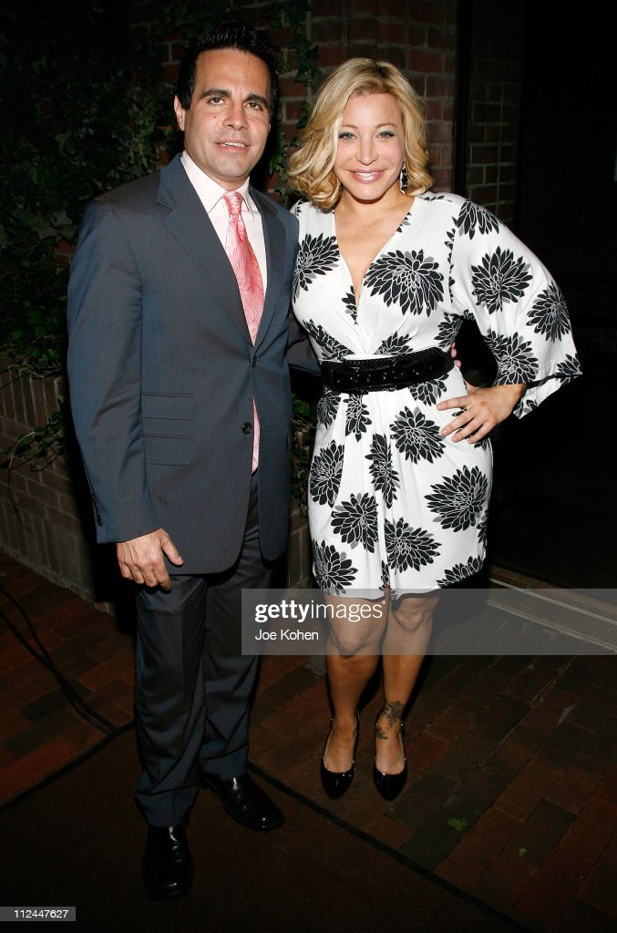 Actor Mario Cantone and singer Taylor Dayne pose inside during the 9th Annual amfAR Honoring With Pride Celebration at the Hudson on June 9 2008 in...