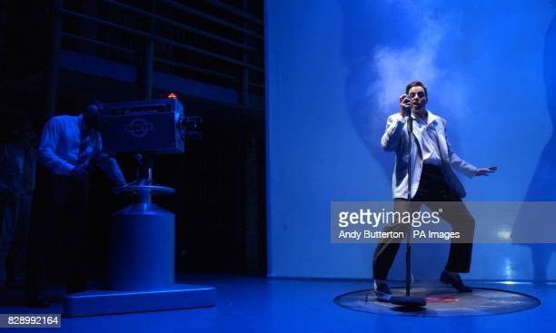 Actor Mario Kombu performs on stage during a photocall for the new musical Jailhouse Rock at the Piccadilly Theatre in west London Created by the...