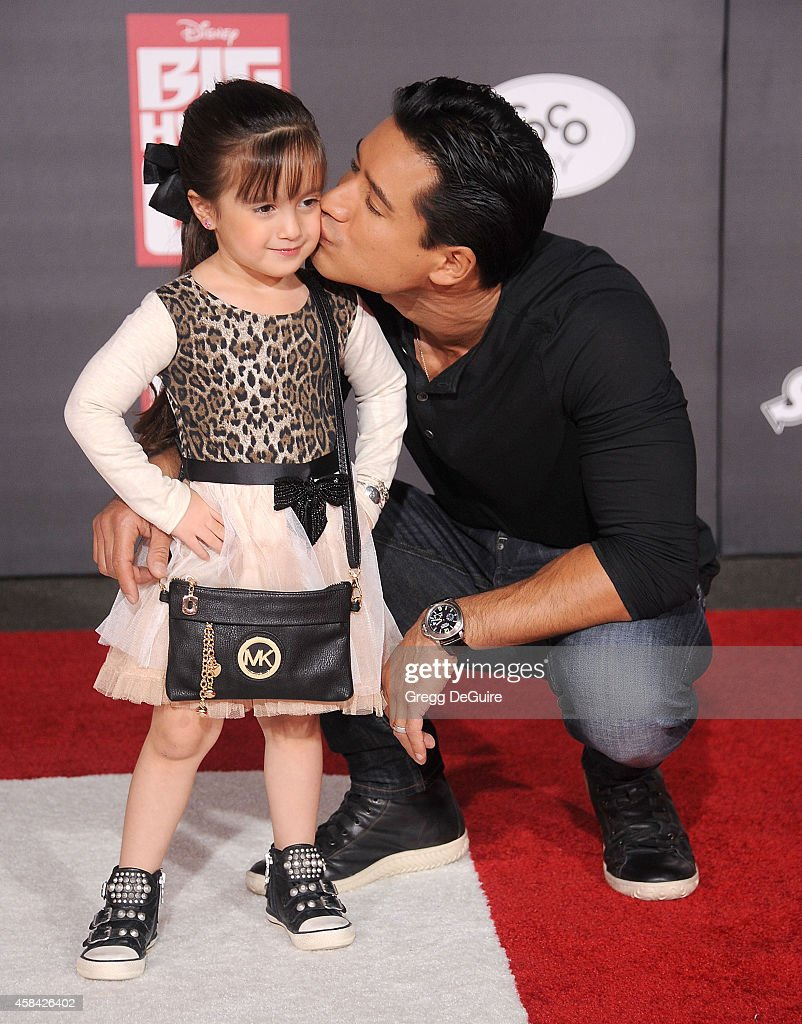 Actor Mario Lopez and daughter Gia Francesca Lopez arrive at the Los Angeles premiere of Disney's 'Big Hero 6' at the El Capitan Theatre on November...
