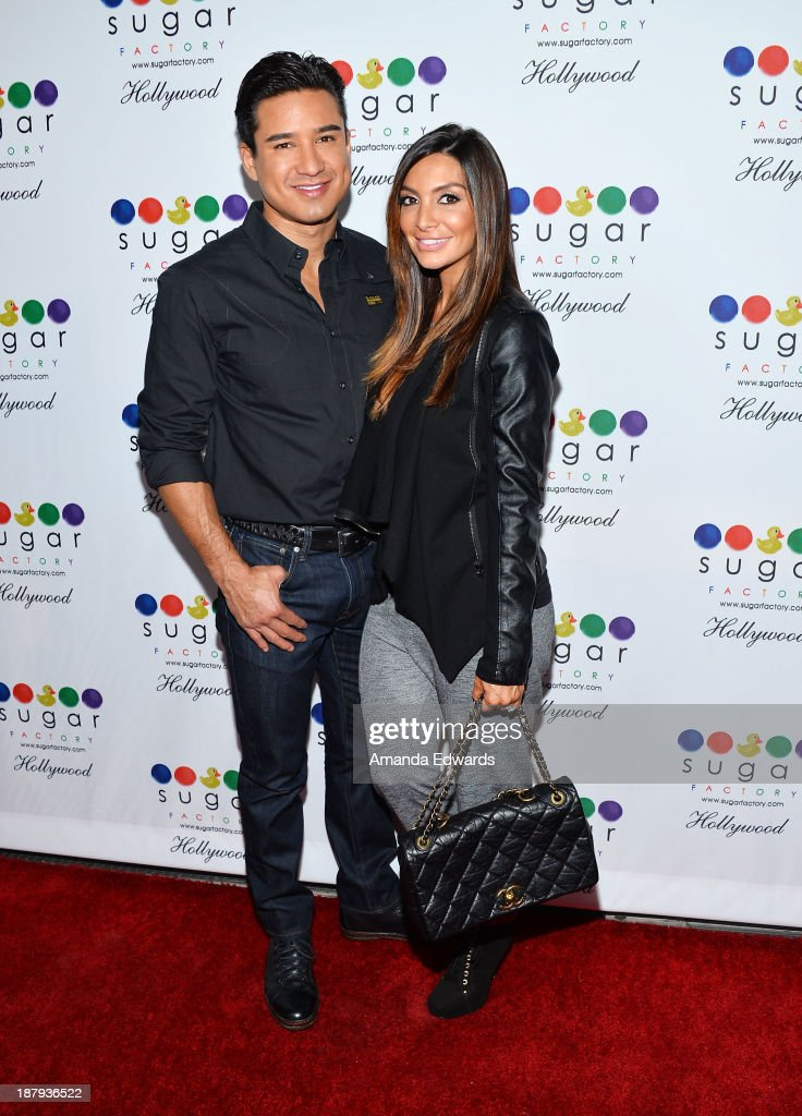 Actor <a gi-track='captionPersonalityLinkClicked' href=/galleries/search?phrase=Mario+Lopez&family=editorial&specificpeople=235992 ng-click='$event.stopPropagation()'>Mario Lopez</a> (L) and his wife <a gi-track='captionPersonalityLinkClicked' href=/galleries/search?phrase=Courtney+Mazza&family=editorial&specificpeople=5650960 ng-click='$event.stopPropagation()'>Courtney Mazza</a> arrive at the grand opening of Sugar Factory Hollywood at Sugar Factory on November 13, 2013 in Hollywood, California.