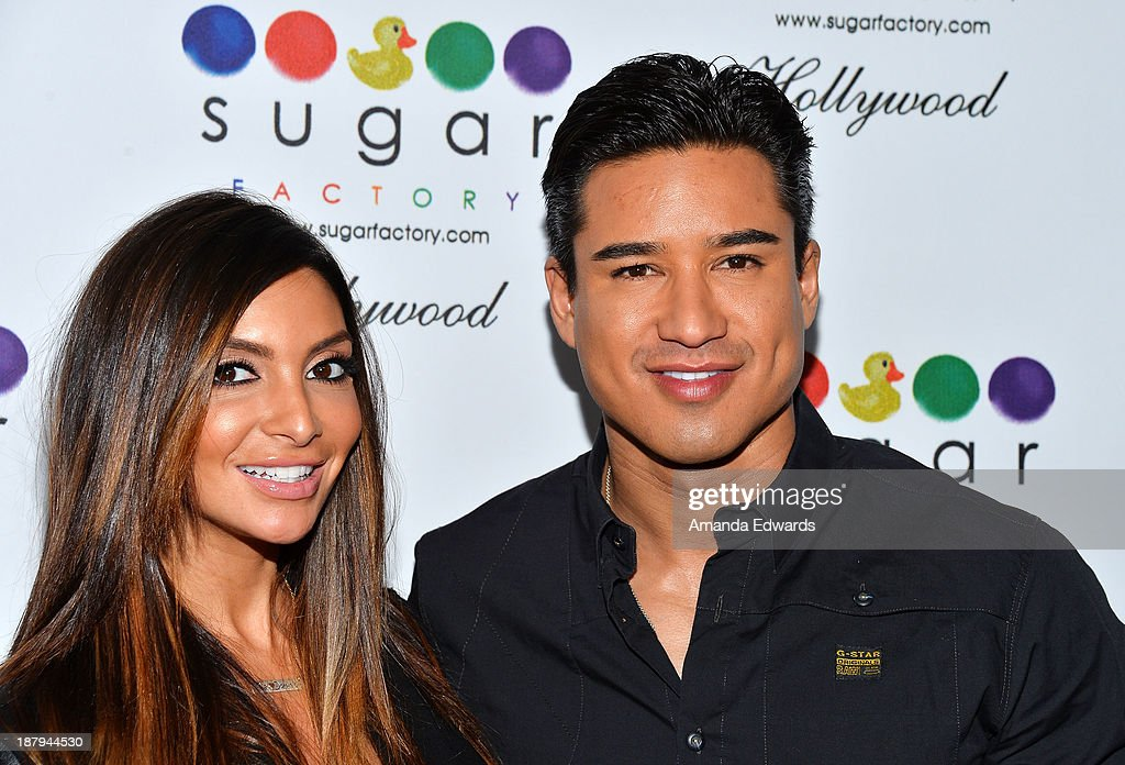 Actor <a gi-track='captionPersonalityLinkClicked' href=/galleries/search?phrase=Mario+Lopez&family=editorial&specificpeople=235992 ng-click='$event.stopPropagation()'>Mario Lopez</a> (R) and his wife <a gi-track='captionPersonalityLinkClicked' href=/galleries/search?phrase=Courtney+Mazza&family=editorial&specificpeople=5650960 ng-click='$event.stopPropagation()'>Courtney Mazza</a> arrive at the grand opening of Sugar Factory Hollywood at Sugar Factory on November 13, 2013 in Hollywood, California.