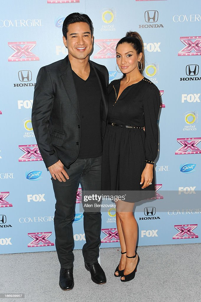 Actor <a gi-track='captionPersonalityLinkClicked' href=/galleries/search?phrase=Mario+Lopez&family=editorial&specificpeople=235992 ng-click='$event.stopPropagation()'>Mario Lopez</a> and wife Courtney Laine Mazza arrive at 'The X Factor' Finalists Party at SLS Hotel on November 4, 2013 in Los Angeles, California.