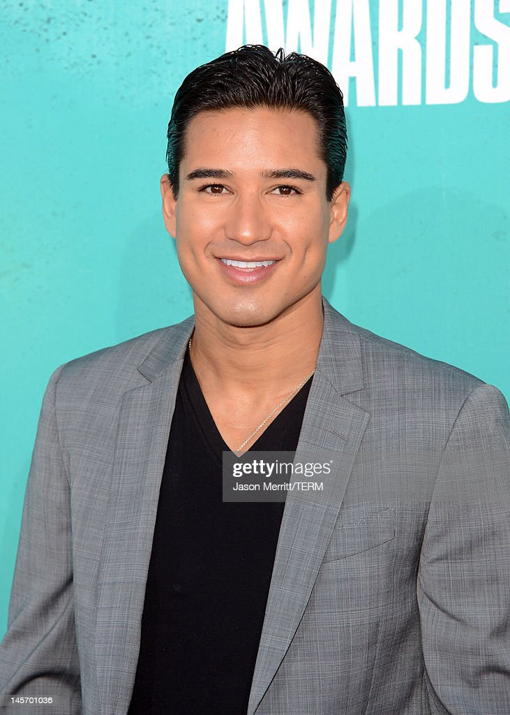 Actor <a gi-track='captionPersonalityLinkClicked' href=/galleries/search?phrase=Mario+Lopez&family=editorial&specificpeople=235992 ng-click='$event.stopPropagation()'>Mario Lopez</a> arrives at the 2012 MTV Movie Awards held at Gibson Amphitheatre on June 3, 2012 in Universal City, California.