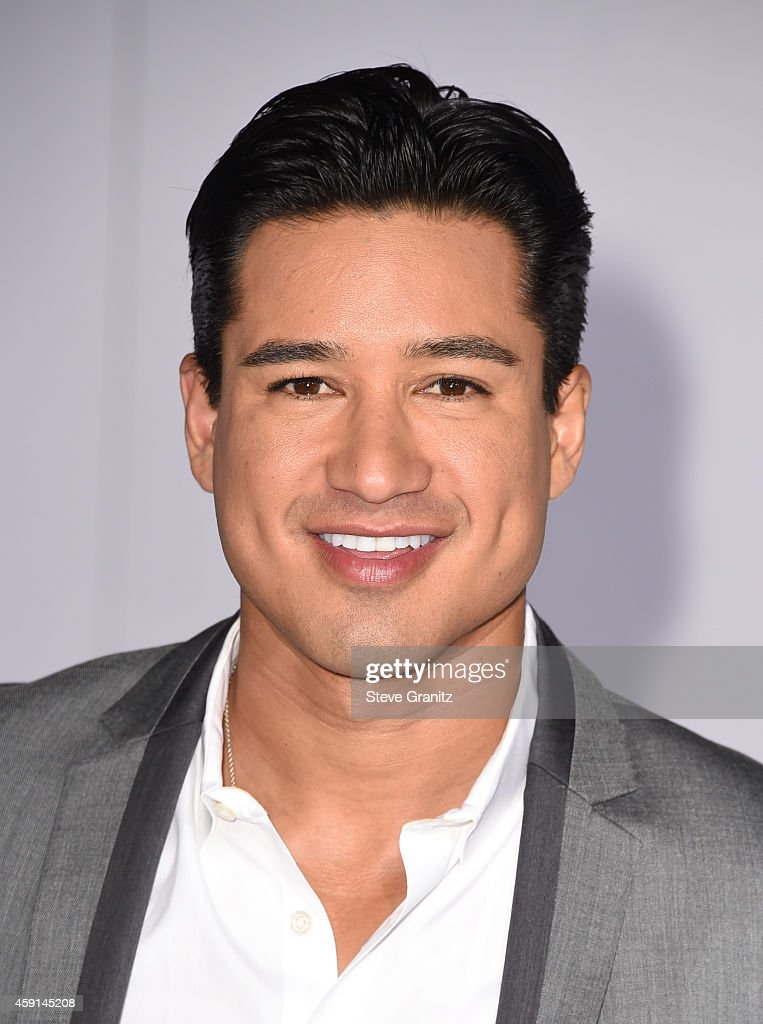 Actor Mario Lopez attends the premiere of 'The Hunger Games Mockingjay Part 1' at Nokia Theatre LA Live on November 17 2014 in Los Angeles California