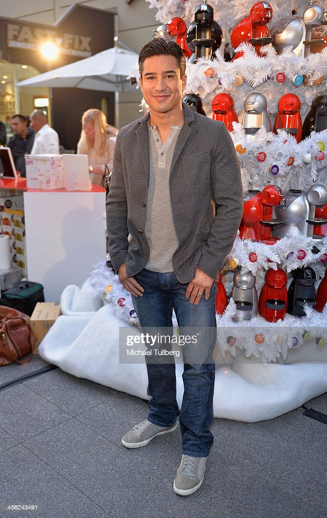 Actor <a gi-track='captionPersonalityLinkClicked' href=/galleries/search?phrase=Mario+Lopez&family=editorial&specificpeople=235992 ng-click='$event.stopPropagation()'>Mario Lopez</a> hosts a tree lighting ceremony at a Nescafe Holiday Pop-Up store at Westfield Century City on December 13, 2013 in Los Angeles, California.