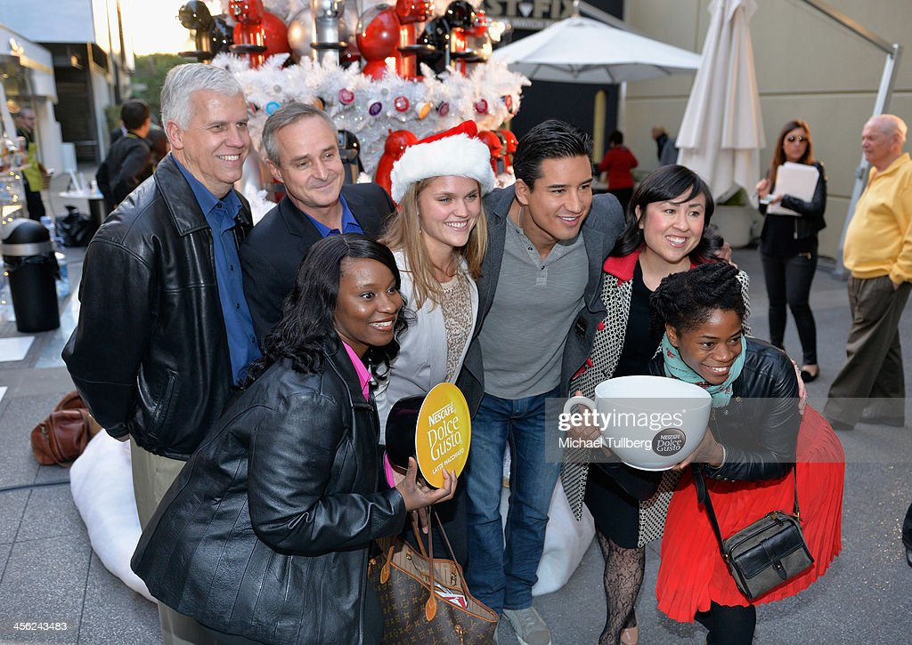Actor <a gi-track='captionPersonalityLinkClicked' href=/galleries/search?phrase=Mario+Lopez&family=editorial&specificpeople=235992 ng-click='$event.stopPropagation()'>Mario Lopez</a> (3rd from R) poses with fans at a tree lighting ceremony at a Nescafe Holiday Pop-Up store at Westfield Century City on December 13, 2013 in Los Angeles, California.