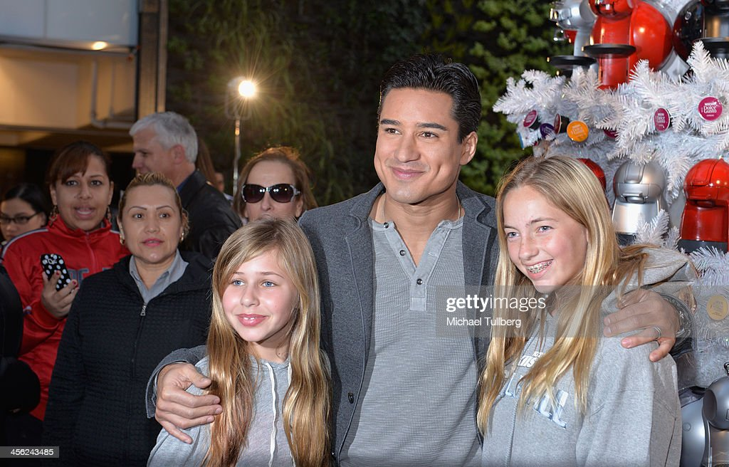 Actor <a gi-track='captionPersonalityLinkClicked' href=/galleries/search?phrase=Mario+Lopez&family=editorial&specificpeople=235992 ng-click='$event.stopPropagation()'>Mario Lopez</a> poses with fans at a tree lighting ceremony at a Nescafe Holiday Pop-Up store at Westfield Century City on December 13, 2013 in Los Angeles, California.