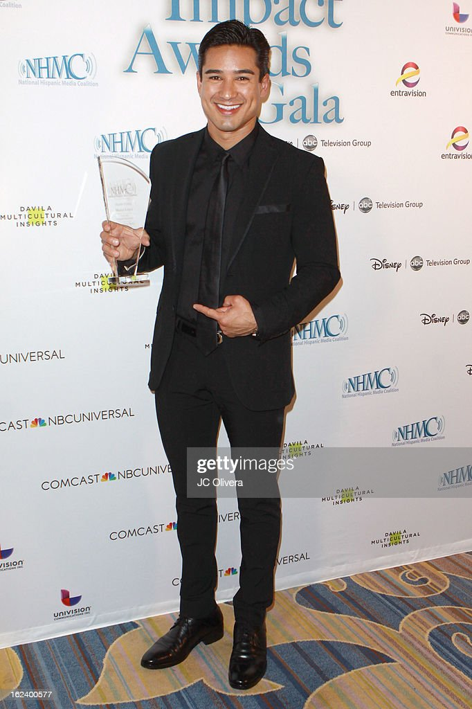 Actor <a gi-track='captionPersonalityLinkClicked' href=/galleries/search?phrase=Mario+Lopez&family=editorial&specificpeople=235992 ng-click='$event.stopPropagation()'>Mario Lopez</a> poses with his Outstanding Media Entrepreneur Award during the National Hispanic Media Coalition's 16th Annual Impact Awards Gala at the Beverly Wilshire Four Seasons Hotel on February 22, 2013 in Beverly Hills, California.