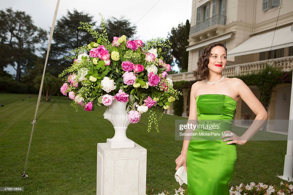 Actor Marion Cotillard wearing a dress by Dior and jewelry by Chopard attends the 22nd Gala for AmFar Cinema Against AIDS. Photographed for Paris Match at the Cap-Eden-Roc hotel on May 21, 2015 in Cap d'Antibes, France.
