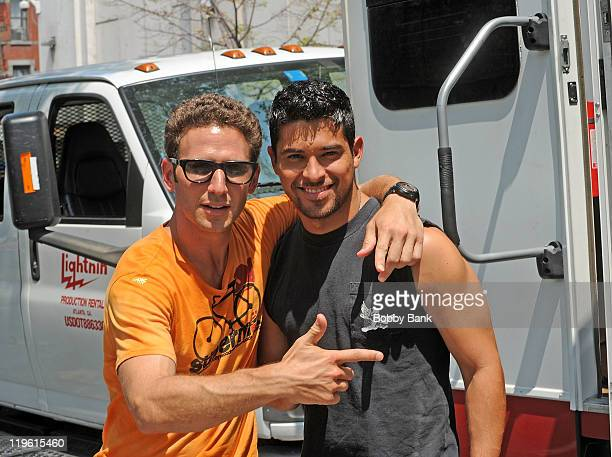 Actor Mark Feuerstein and actor Wilmer Valderrama seen on location for 'Royal Pains' on the streets of Manhattan on July 22 2011 in New York United...