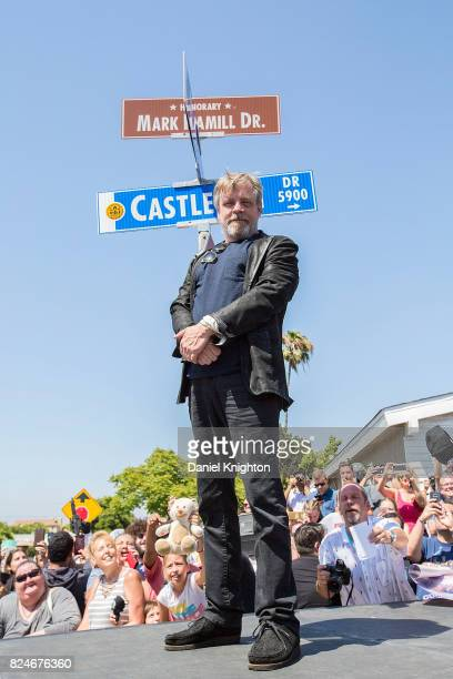 Actor Mark Hamill of Star Wars poses next to a street sign dedicated in his honor on July 30 2017 in San Diego California