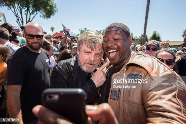 Actor Mark Hamill of Star Wars takes selfies with fans at the Mark Hamill Drive Dedication on July 30 2017 in San Diego California