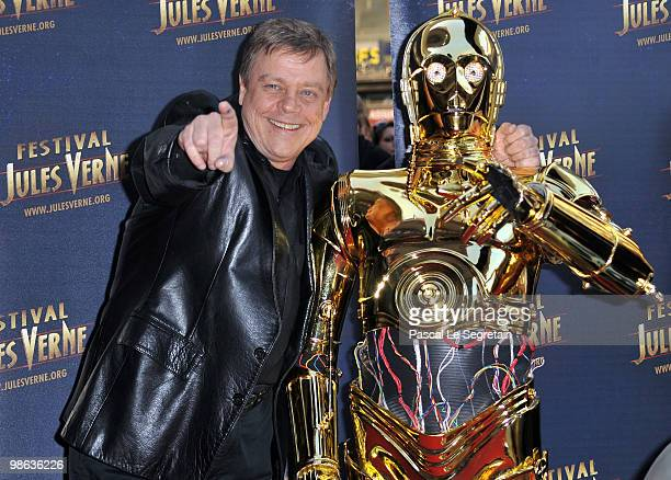 Actor Mark Hamill poses with C3PO as he attends a Tribute to Star Wars V during the 18th Adventure Film Festival at Le Grand Rex on April 23 2010 in...