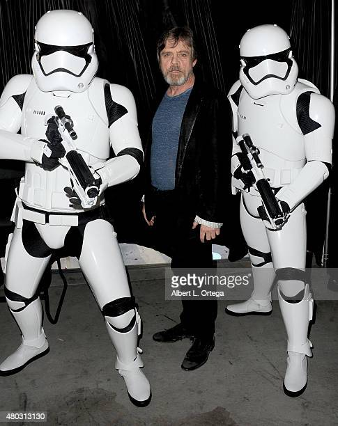 Actor Mark Hamill poses with Imperial Stormtroopers at the Lucasfilm panel during ComicCon International 2015 at the San Diego Convention Center on...