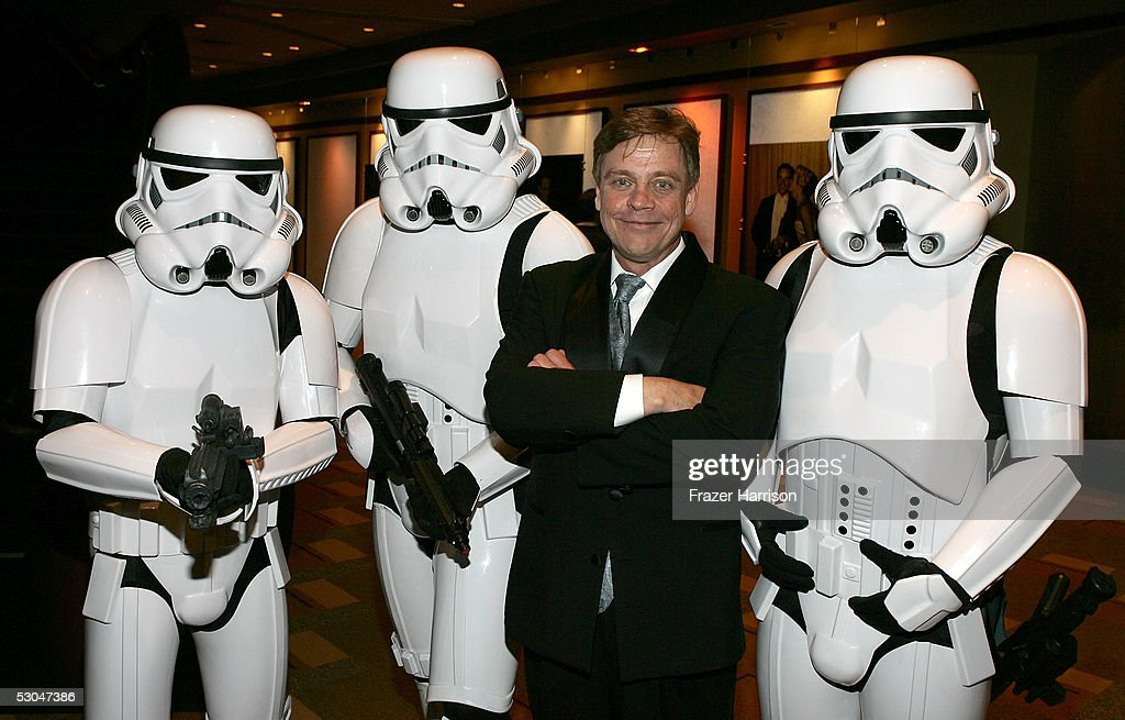 Actor Mark Hamill poses with storm troopers as he departs the 33rd AFI Life Achievement Award tribute to George Lucas at the Kodak Theatre on June 9, 2005 in Hollywood, California.