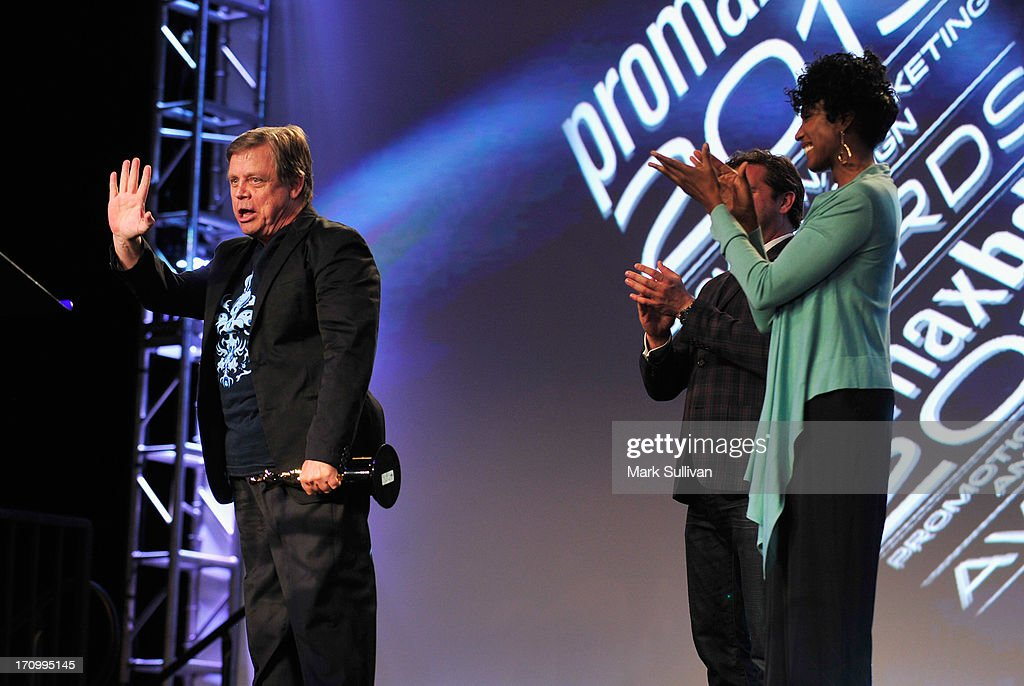 Actor <a gi-track='captionPersonalityLinkClicked' href=/galleries/search?phrase=Mark+Hamill&family=editorial&specificpeople=206396 ng-click='$event.stopPropagation()'>Mark Hamill</a> (L) receives the Don LaFontaine Award as Jonathan Block-Verk, President and CEO of PromaxBDA Global International and Nita Whitaker look on at PromaxBDA Promotion, Marketing And Design Awards Show at JW Marriott Los Angeles at L.A. LIVE on June 20, 2013 in Los Angeles, California.