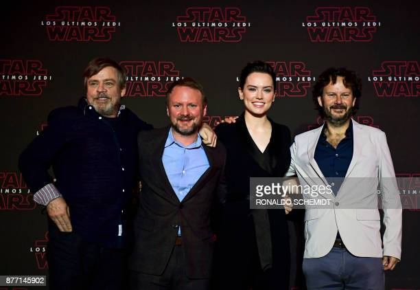 US actor Mark Hamill US film director Rian Johnson British actress Daisy Ridley and Israeli film producer Ram Bergman pose for pictures after...