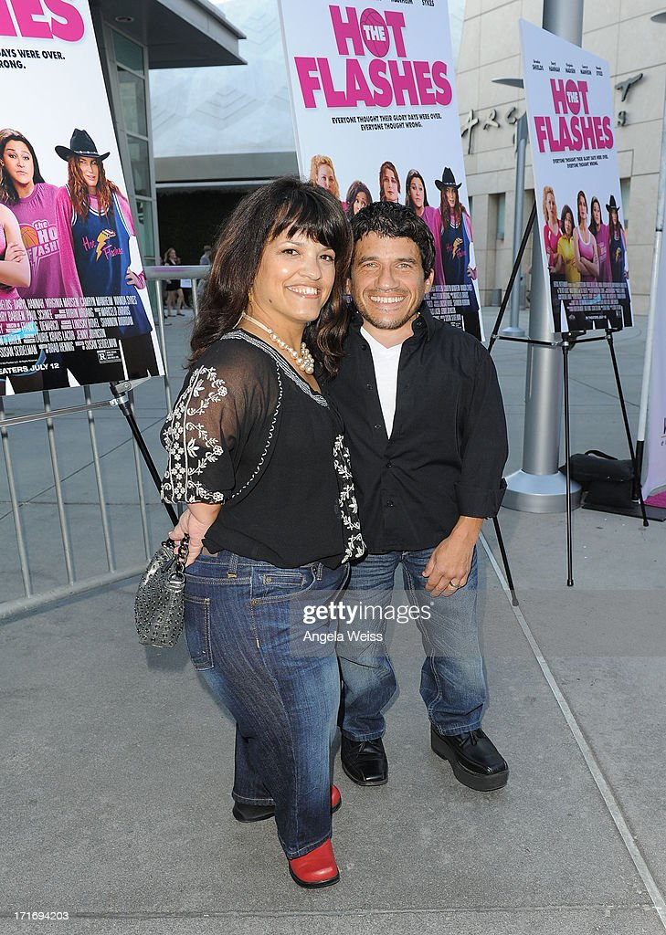 Actor Mark Povinelli (R) and wife Heather Davis arrive at the premiere of 'The Hot Flashes' at ArcLight Cinemas on June 27, 2013 in Hollywood, California.
