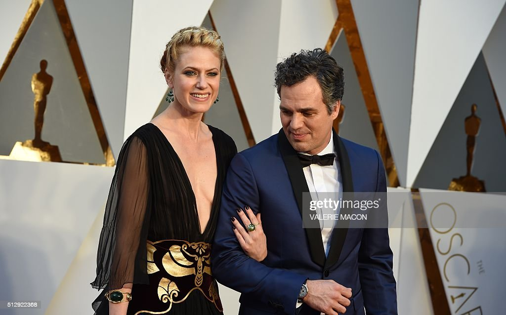 Actor Mark Ruffalo and his wife Sunrise Coigney arrive on the red carpet for the 88th Oscars on February 28 2016 in Hollywood California AFP PHOTO /...