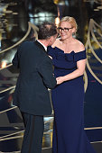 Actor Mark Rylance accepts the Best Supporting Actor award for 'Bridge of Spies' from actress Patricia Arquette onstage during the 88th Annual...
