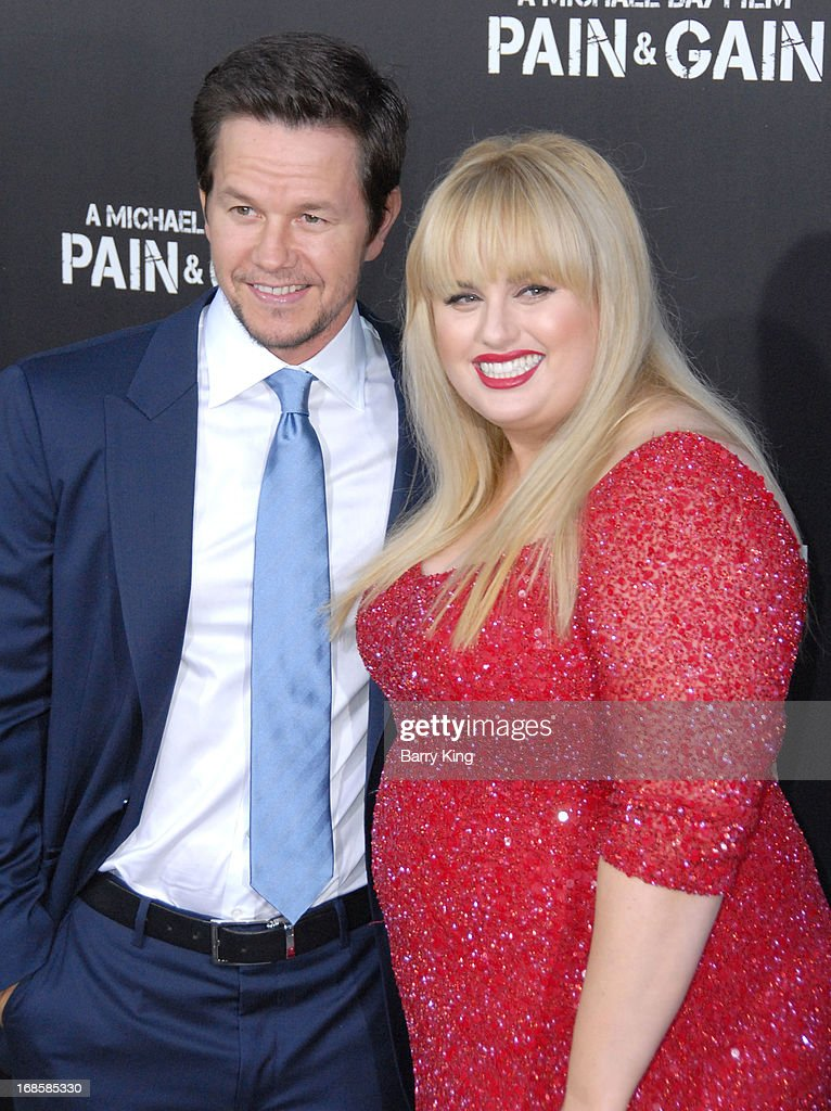Actor Mark Wahlberg (L) and actress Rebel Wilson arrive at the Los Angeles Premiere 'Pain & Gain' at TCL Chinese Theatre on April 22, 2013 in Hollywood, California.