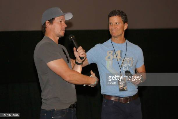 Actor Mark Wahlberg and Brian Goldner Hasbro Chairman CEO/Executive Producer speak to guests during a special screening of 'Transformers The Last...