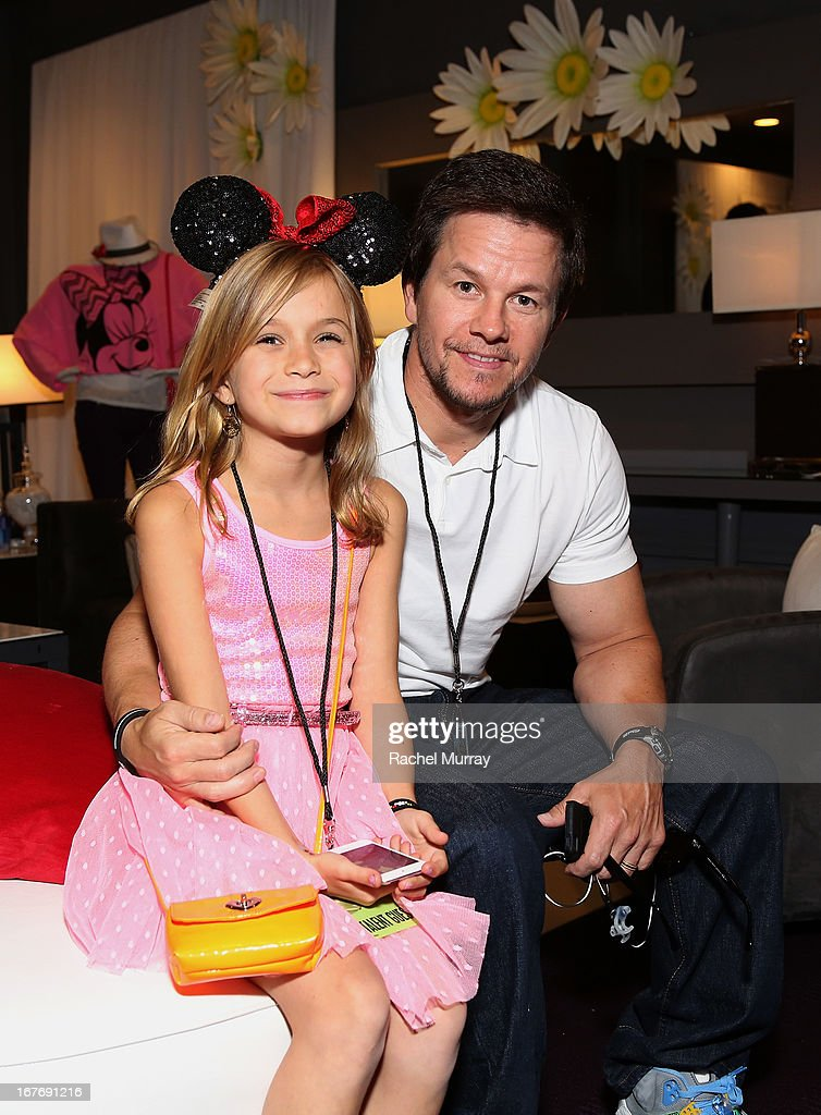 Actor Mark Wahlberg (R) and daughter Ella Wahlberg attend the Minnie Gifting Lounge during the 2013 Radio Disney Awards at Nokia Theatre L.A. Live on April 27, 2013 in Los Angeles, California.