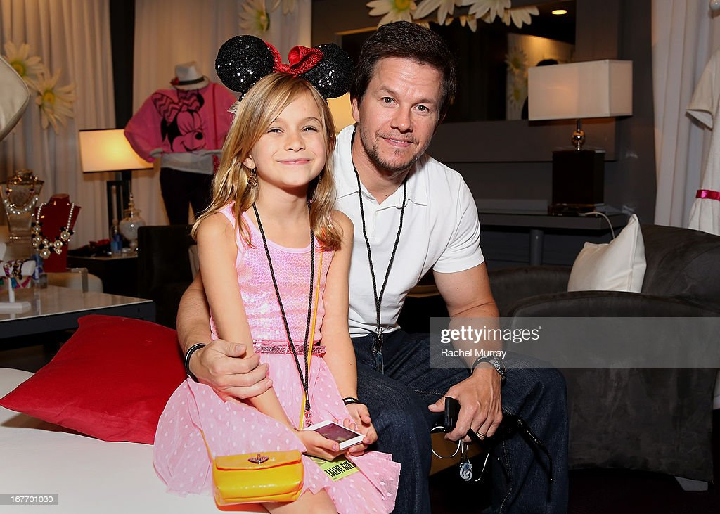 Actor <a gi-track='captionPersonalityLinkClicked' href=/galleries/search?phrase=Mark+Wahlberg&family=editorial&specificpeople=202265 ng-click='$event.stopPropagation()'>Mark Wahlberg</a> (R) and daughter Ella Wahlberg attend the Minnie Gifting Lounge during the 2013 Radio Disney Awards at Nokia Theatre L.A. Live on April 27, 2013 in Los Angeles, California.