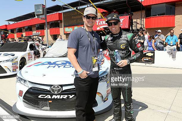 Actor Mark Wahlberg and driver Blake Koch attend the Drive4Clotscom 300 with AQUAhydrate and Koch Racing at Auto Club Speedway on March 21 2015 in...