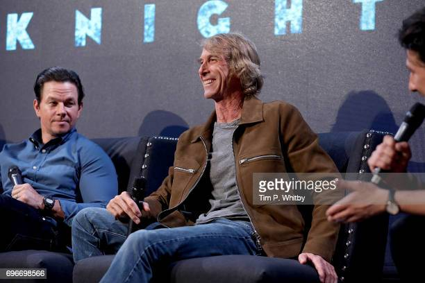 Actor Mark Wahlberg and film director Michael Bay attend a fan event for 'Transformers The Last Knight' at St Barts the Great on June 16 2017 in...