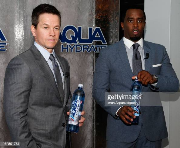 Actor Mark Wahlberg and producer/entrepreneur Sean Combs pose onstage while hosting a press conference to announce their newest venture Water Brand...
