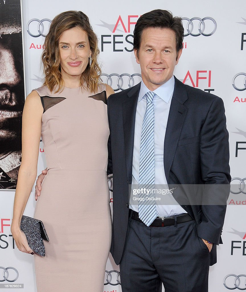 Actor Mark Wahlberg and wife Rhea Durham arrive at the AFI FEST 2013 for the 'Lone Survivor' premiere at TCL Chinese Theatre on November 12 2013 in...