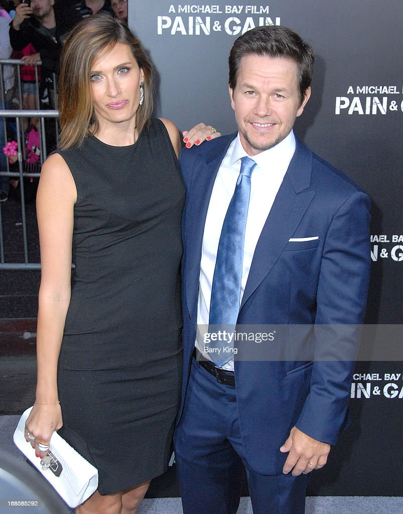 Actor Mark Wahlberg and wife Rhea Durham arrive at the Los Angeles Premiere 'Pain & Gain' at TCL Chinese Theatre on April 22, 2013 in Hollywood, California.